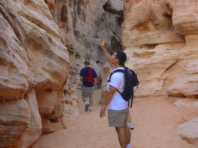 Exploring a sandy slot canyon in Valley of Fire State Park