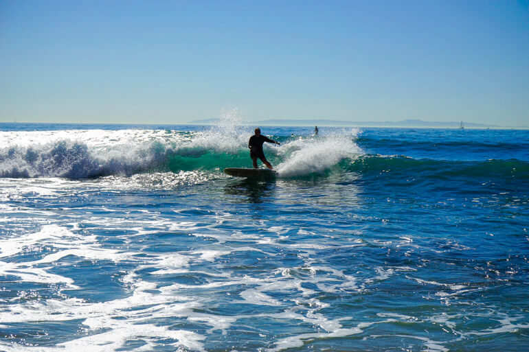 Surfing at Crystal Cove Beach