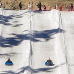 Snow Tubing Down A Winter Mountain