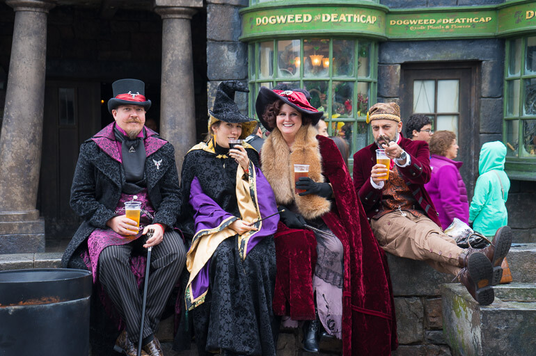 Harry Potter fans in Hogsmeade enjoying Butterbeer